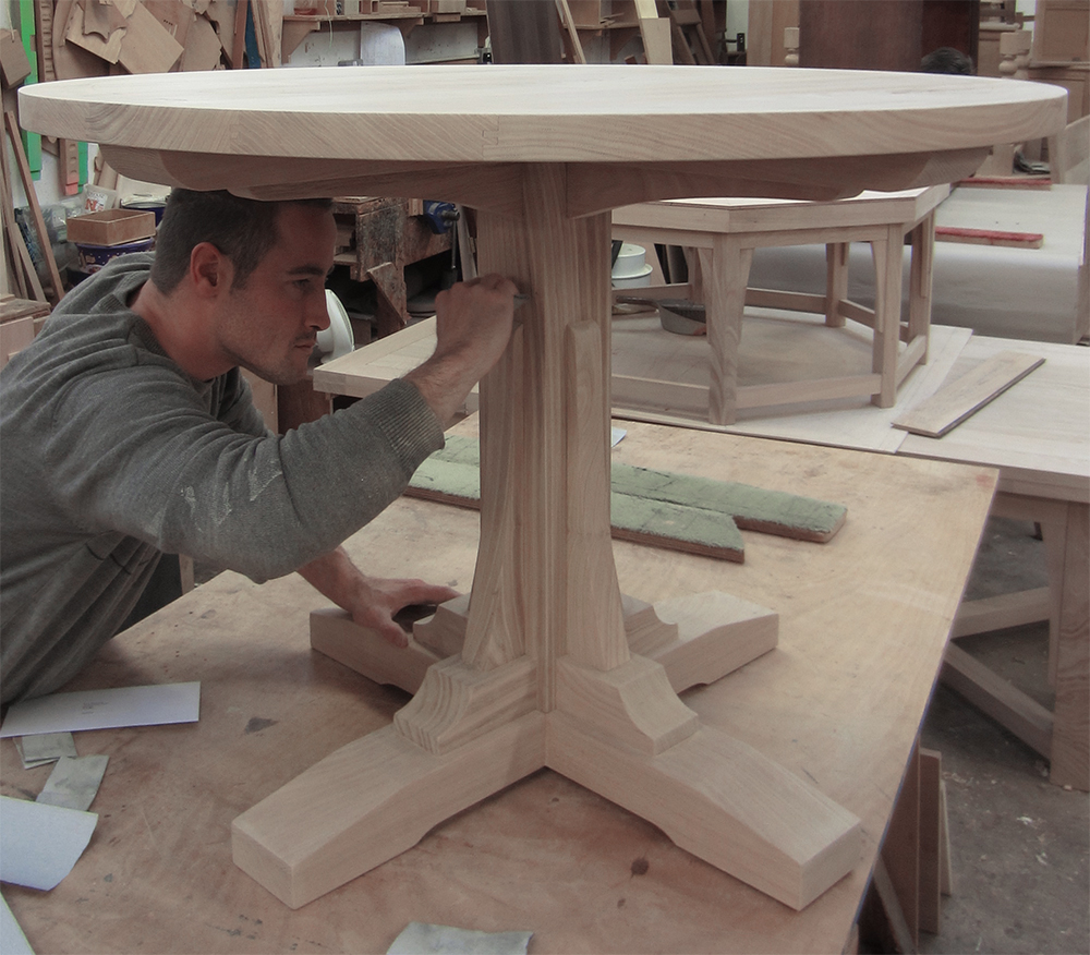 A circular breakfast table being worked on by Phil in our workshop