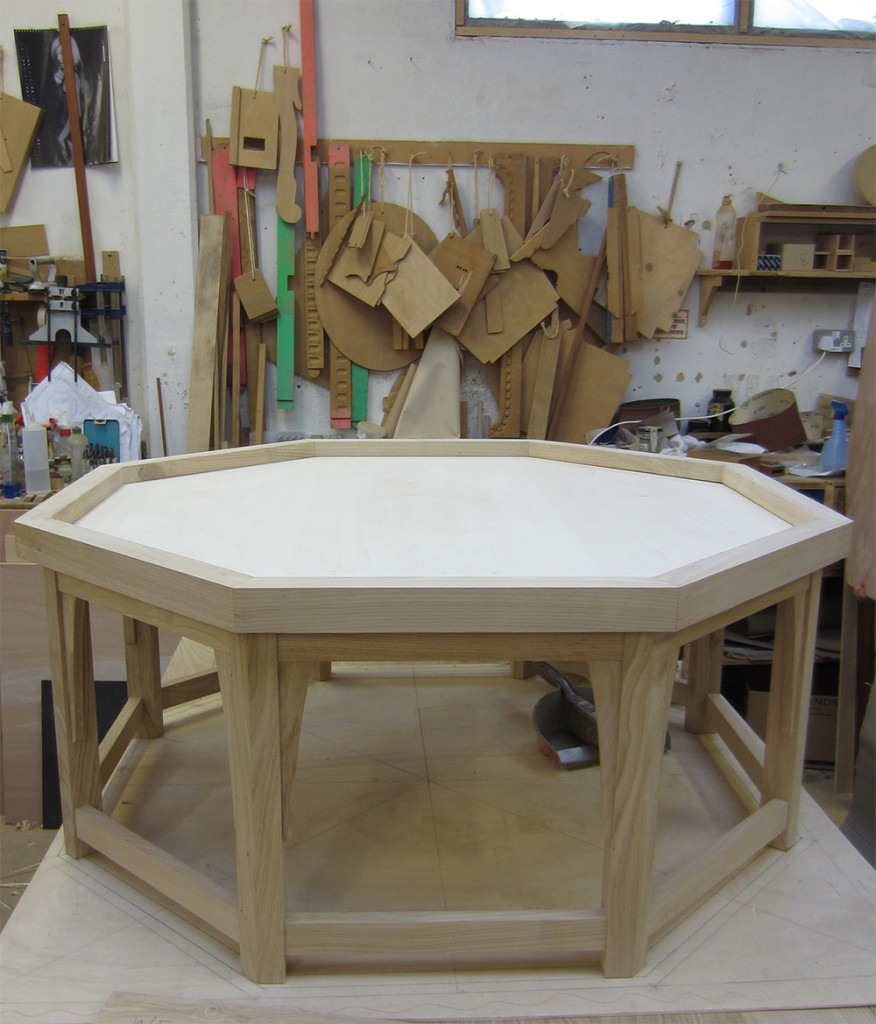 Hexagonal coffee table made to fit around our clients' piece of marble