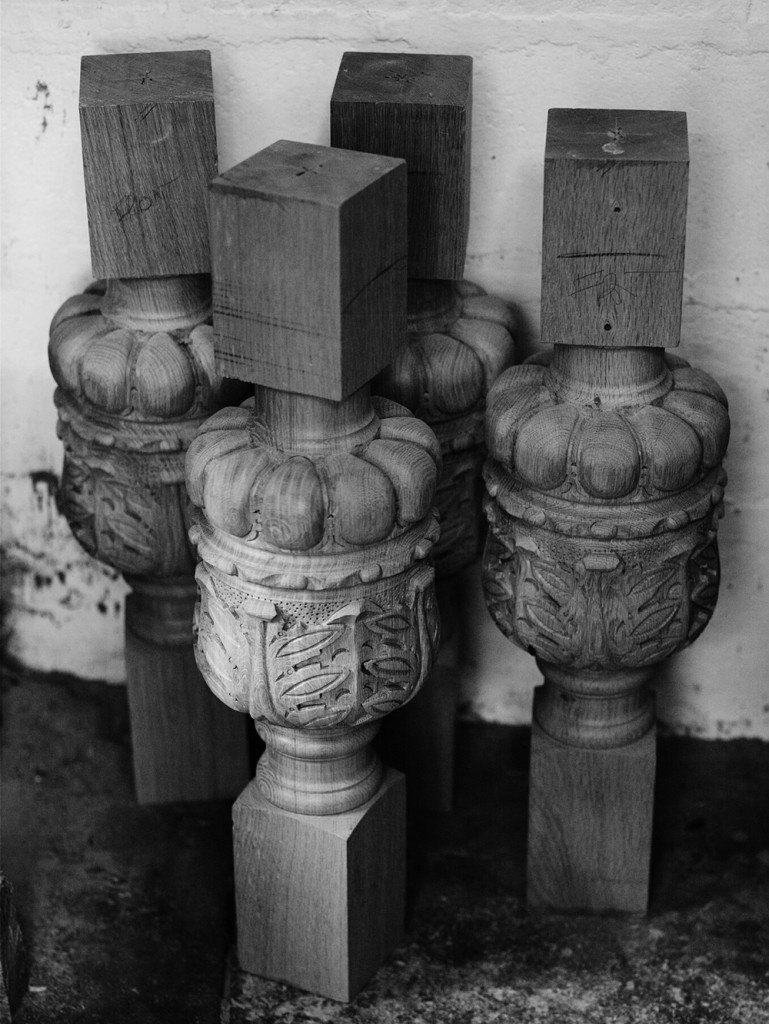 Four hand-carved table legs.
