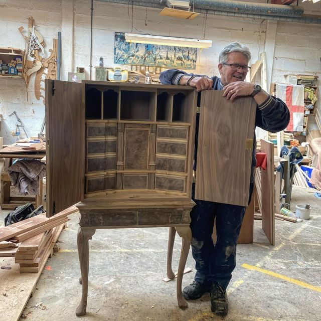 """It's all in the details for Alan Noble  Showcasing one of our experienced cabinet makers Alan;  With over 41 years of experience at Titchmarsh and Goodwin, Alan has mastered his craft to produce this beautiful bespoke burr walnut cabinet on stand.  """"The satisfaction of finishing a piece like this is what makes my job so special, we can really show off our attention to detail, personally for me I love creating hand done dove tail joints."""""""
