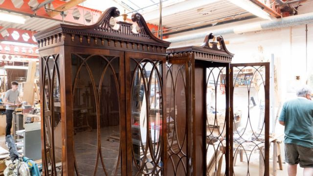 A pair of stunning Chippendale influenced mahogany glazed display cabinets.   Beautiful elliptical glazing bars inlaid with kingwood, hand cut glass traditionally set with linseed oil putty.  Swan neck open fretwork pediment sets of this piece beautifully.  British craftsmanship at its best.   RL-22826/CS